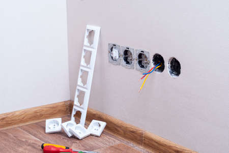 Modules of electrical outlets are installed in the wall Stock Photo