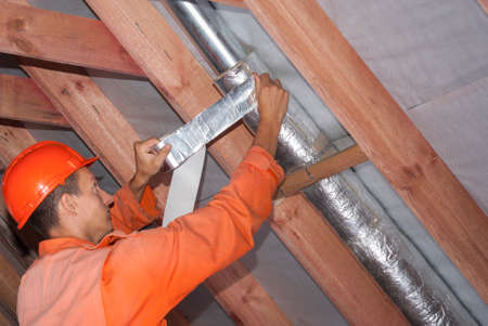 installer wraps the air duct with mineral wool and foil