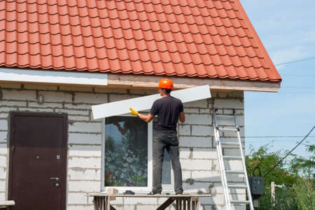 roofing system: builder makes the eaves of the roof Stock Photo