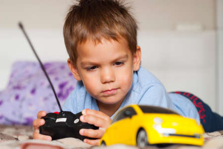 little boy and car on the radio control