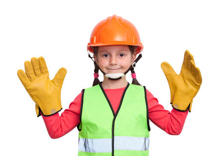 little girl in uniform and helmet imagines herself an industrial worker