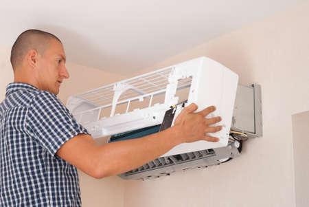 master installs indoor unit of the air conditioner