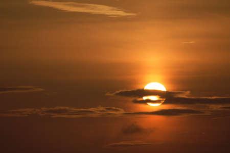 Orange sunrise behind a clouds photo