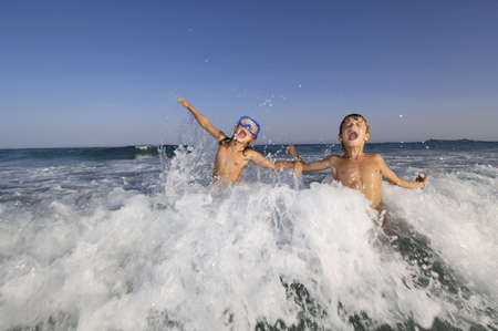 kids playing water: kids playing in the sea