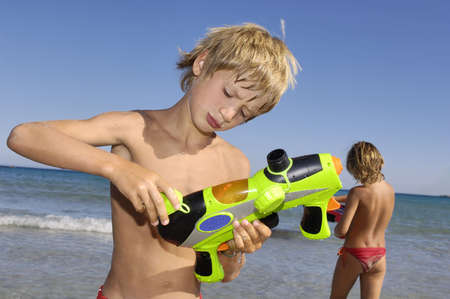 Portrait of a young boy with water gun photo