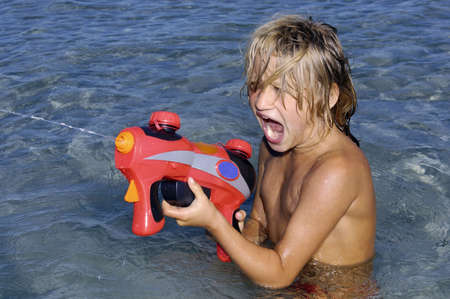 Young girl with water gun photo