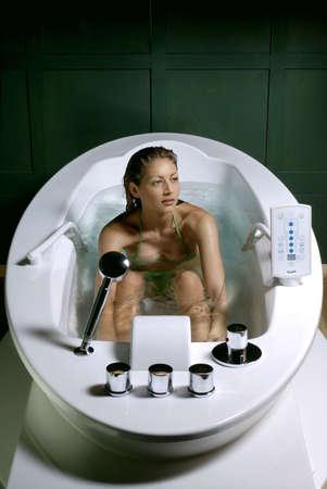 hydromassage: Young woman and hydromassage