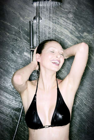 Happy woman in the shower