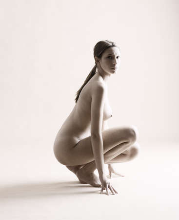 Naked woman in studio photo