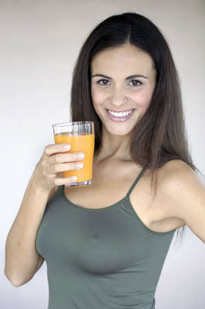 Beautiful woman drinking orange juice photo