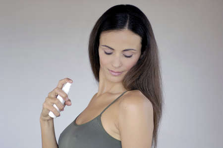woman holding deodorant