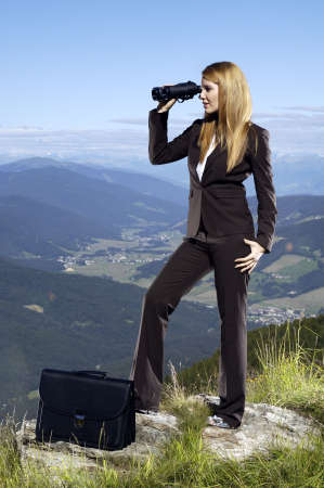 woman with briefcase holding binoculars photo