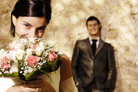 Bride with flowers hiding her face photo