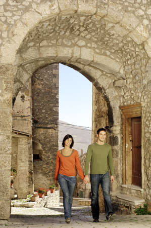 Couple walking in a rural village Standard-Bild