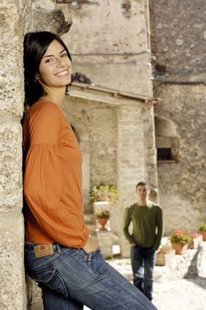 latin woman standing and smiling