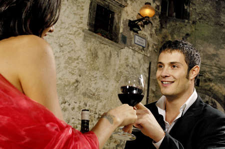 man with glass of red wine during a dinner