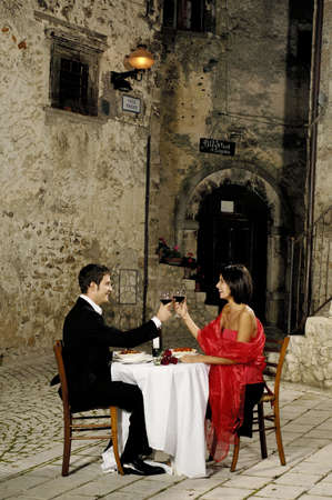 young couple toasting with wine