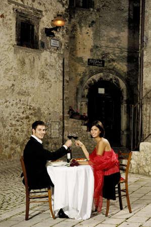 village man: couple toasting at restaurant