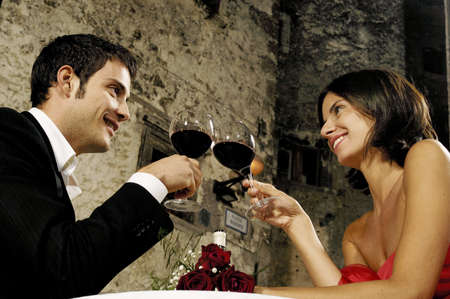 happy couple with red wine Standard-Bild