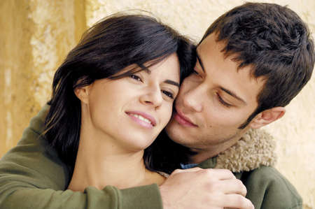 couple embracing and caressing photo