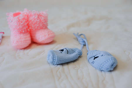 booty: Knitted pink baby shoes and blue gloves