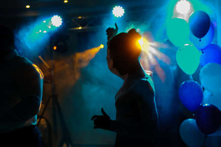 light show: Disco lights and show. Concept about entertainment and party. Balloons and smoke