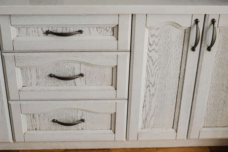 old furniture: antique white painted cupboard closet, old hand made furniture in wood with drawers and doors