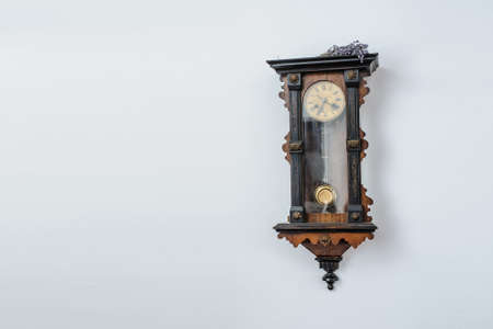 Antique old vintage wooden wall clock. Interesting view