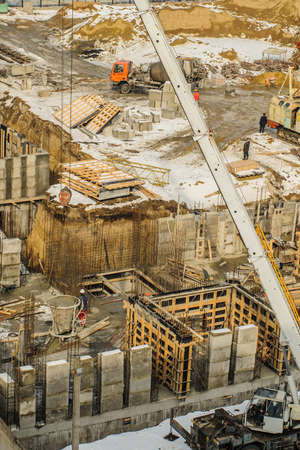 crane bucket: Tower crane bucket full of concrete liquid is delivering to the site.  Stock Photo