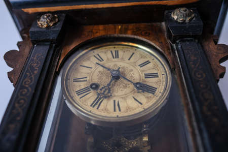 pendulum: Antique old vintage wooden wall clock. Interesting view