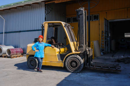 truck driver: Portrait of Female Lift Truck Driver In Factory outdoor  Stock Photo