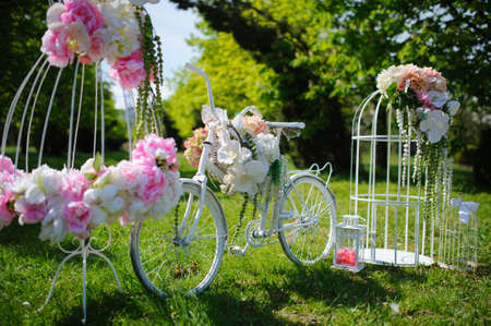 Wedding composition with white bicycle and flowers