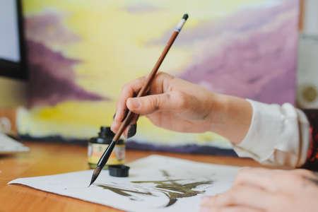 Female artist paint hand writing chinese calligraphy