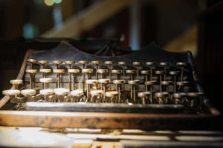 Old way of writing messages: vintage typewriter on the desk full of cobweb