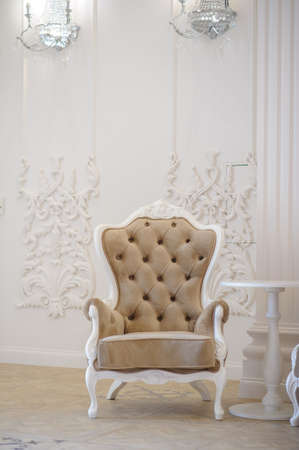 Armchair leather and wood in a banquet hall, with white and gold domination Stock Photo