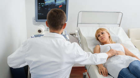 The pregnant lady pacient at ultrasonography examination, close view Stock Photo