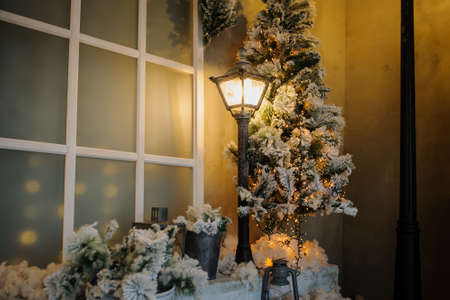 Photography studio with christmass decorations and vintage streetlamps