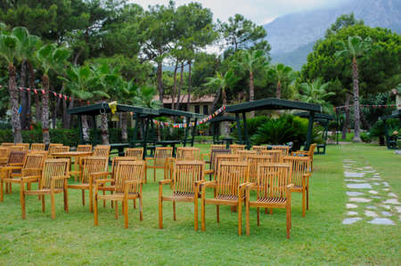 wooden chairs arranged as a cinema hall outdoors