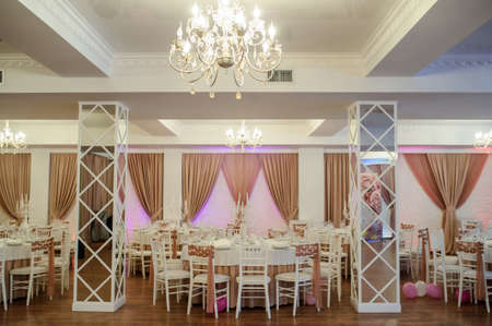 banquet hall in white and brown colors decorated for the event