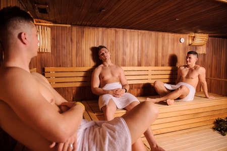 close up photo of 3 men resting in russian sauna