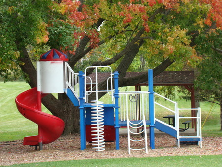 Park with playground in autumn photo