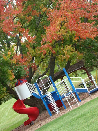 Small Park with playground in autumn