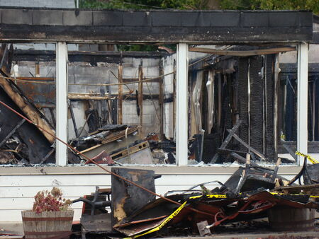 smoldering: Business destroyed by major fire