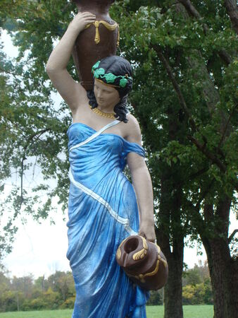 women's issues: Statue of woman carrying water