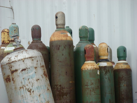 argon: Group of Old bottled gas Cylinders