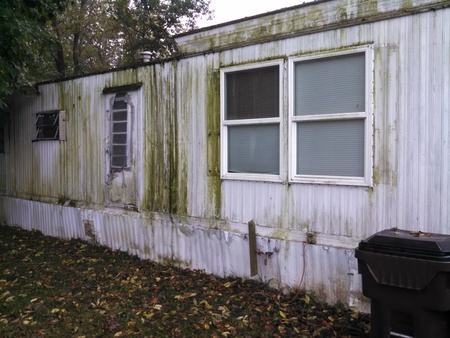 run down: Run down mobile home covered with mold