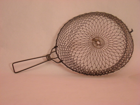 burned out: Vintage deep fryer basket Stock Photo