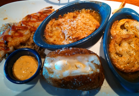 Shrimp seafood meal with baked potato photo