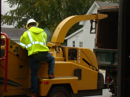 Man working on wood chipper
