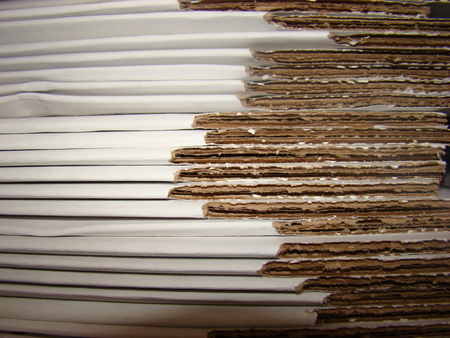un used: stack of flat cardboard boxes